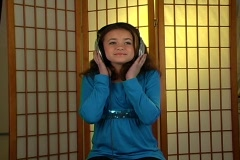 Beautiful Adolescent Girl Listens to Music with Headphones (1) Stock Footage