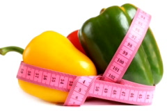 Tape measure wrapped around rotating three peppers, loopable Stock Footage
