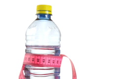 Tape measure wrapped around bottle of water, loopable - stock footage
