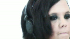 Emo chick listening to small headphones - 1 - focused Stock Footage