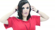 Emo chick listening to small headphones - 5 - what's that again? Stock Footage