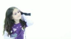 Cute little girl listens to music - 4 - one ear little rapper - stock footage