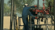 Stock Video Footage of Manual Workers on Oil Rig (Editorial)