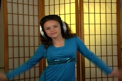 Beautiful Adolescent Girl Listens to Music with Headphones (2) Stock Footage