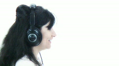 Sexy Brunette Goth chic listening to headphones - 4 - right face profile Stock Footage