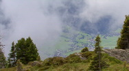 TL clouds over austrian valley Stock Footage