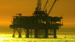 Helicoptor Flying from Oil Rig - stock footage