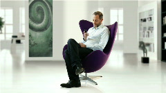 businessman in design chair  - stock footage