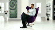 Businessman in design chair  Stock Footage