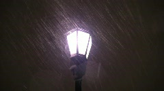 Snow against streetlight silent 30s Stock Footage