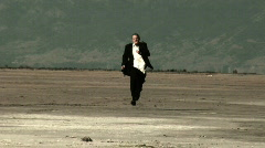 Business Man Running In Desert Stock Footage