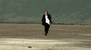 Stock Video Footage of Business Man Running In Desert