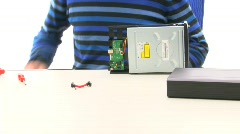Installing a DVD drive in a housing Stock Footage