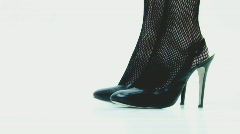 High heels and fishnets - 2 - left leg step back Stock Footage