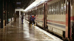 Railway workers on platform - editorial Stock Footage