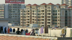 Roof top drying clothes China Stock Footage
