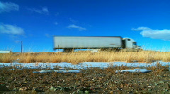White Semi Truck Passes on Highway Stock Footage
