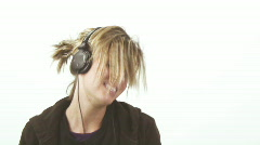 Hip girl wearing small headphones - 2 - 5 sing along intensly Stock Footage