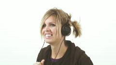 Hip girl wearing small headphones - 2 - 3 gag me! yuck! - stock footage