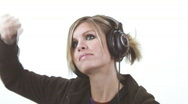 Cute blond on the headphones - 7 - roll, as in rock and roll  Stock Footage