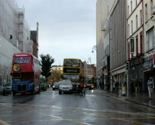 Busy traffic cityscape with double decker buses Stock Footage