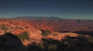 Stock Video Footage of (1132b) Mesa Arch Canyonlands Sunset Full Moon Over Utah Mountains