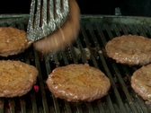 Stock Video Footage of Flipping burgers on barbecue grill with sound