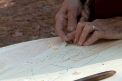 Craftsman chiseling a design in wood Stock Footage