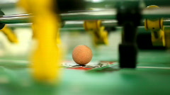 Foosball table hitting ball Stock Footage