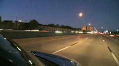 A car cruises along the highway - stock footage
