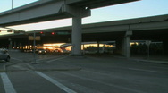 Traffic flows under a busy highway Stock Footage