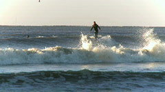 Surfers in the early morning (5 of 6) - stock footage