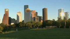 Joggers run beneath the Houston skyline Stock Footage
