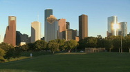 Stock Video Footage of Joggers run beneath the Houston skyline