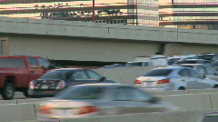 Rush hour traffic on builds on an interstate (3 of 5) - stock footage
