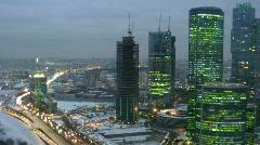 Modern city: skyscrapers, movement on highway. Gradually darkens. Stock Footage