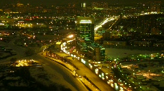 Brisk movement on a highway in a modern city in night. Time lapse. Stock Footage