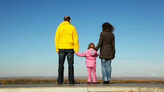Family of mum, daddies and daughter goes upwards from platform Stock Footage
