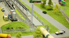 Train pushes tank wagon on rail in modern toy city to fuel station Stock Footage