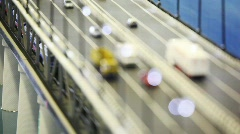 Toy tiny automobile cars, trucks and train stand on bridge. Changing focus Stock Footage