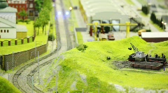 In small model city two trian move on meeting each other on rail Stock Footage