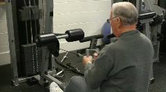 Elderly Man On Row Machine Stock Footage