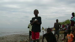 Displaced Haitian boys looking at helicopter fly overhead  (HD) Stock Footage