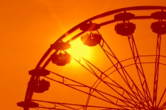 Ferris wheel detail. Dreamy orange sunset. Stock Footage