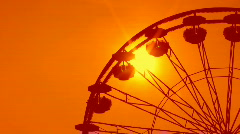 Ferris wheel detail. Dreamy orange sunset. - stock footage