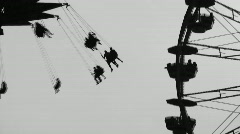 Stock Video Footage of Fairground silhouettes. Two shots.