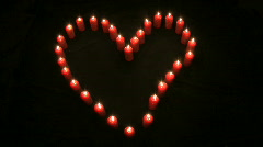Heart shaped candle stop motion Stock Footage