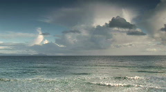 Ocean waves coming into shore with clouds behind Stock Footage