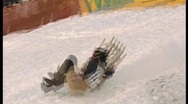 Stock Video Footage of wipe out on sledge, funny winter olympics.7
