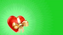 Valentine video card - heart with gold ribbon on green loop Stock Footage